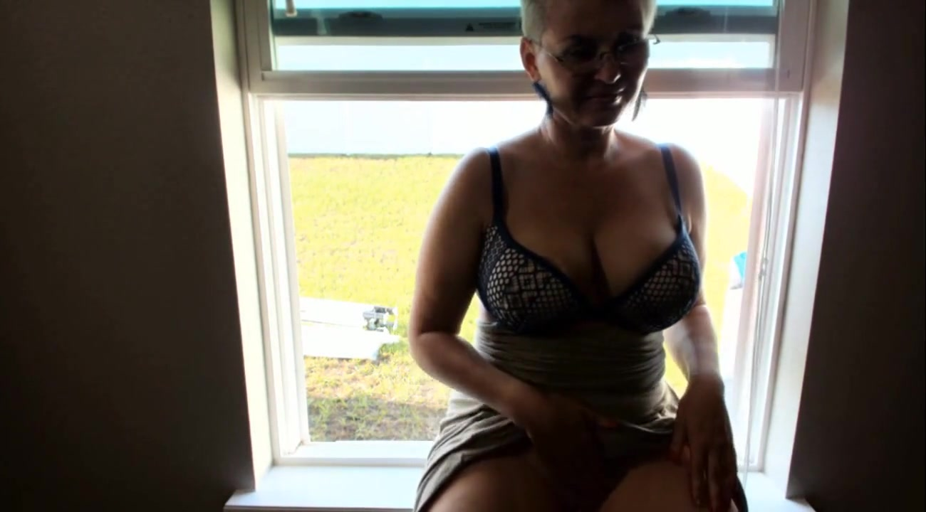 Horny Nude Busty Cougar Masturbating By The Window For Neighbours